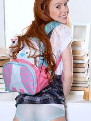 Redhead teen Dolly Little strips for you after class