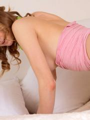 Redhead teen Patritcy A strips for you in bed