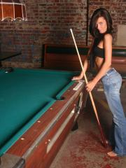 Hot coed Lexi strips and teases on the pool table