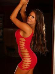 Curvy babe Lexy shows off in a skimpy slutty tight red dress with rips in all the right places
