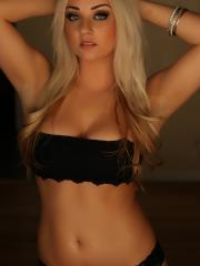 Stunning blonde babe Ashlyn teases in a skimpy black outfit