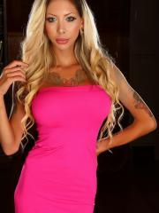 Tattooed babe Chanel shows off her huge boobs in a skin tight hot pink dress
