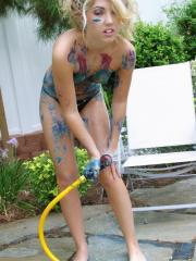 Pictures of Sarah Peachez painted and washing off