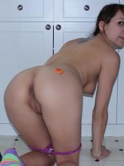 Andi Land gets naughty on the kitchen floor with her fruit
