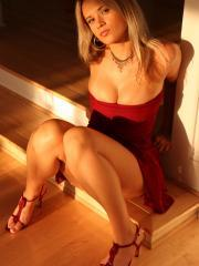 Pictures of Ann Angel dressed in a sexy red dress and heels