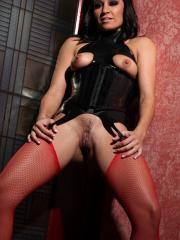 Pictures of Ann Marie Rios dressed up in sexy leather and red fishnets