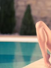 Ariel Rebel strips and teases in her beanie by the pool