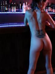 Brunette babe Bailey Knox strips out of her bikini at the bar