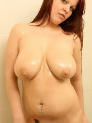 Pictures of redhead girl Ruby getting all wet in the shower