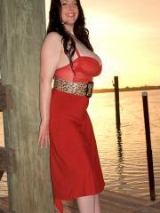 Busty hottie Angela White shows you what's under her red dress