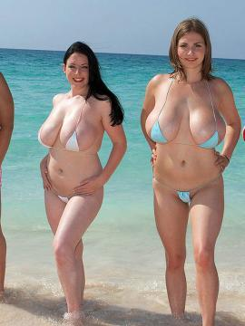 Angela White gets together with her busty girlfriends for some fun on the beach