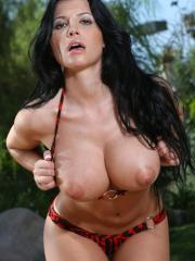 Rebeca Linares shows her huge boobies in a zebra striped bikini