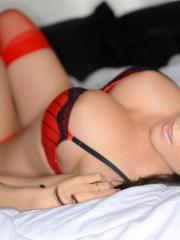 Bryci puts on red stockings and masturbates in bed