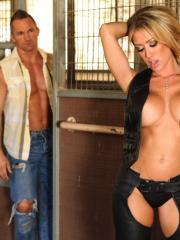Busty blonde babe Capri gets fucked in her leather chaps in the stables