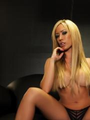 Busty blonde hottie Capri moves her panties to the side to reveal her tight pussy