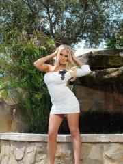 Cara Brett slips out of her tight white dress and panties