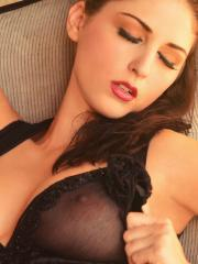 Hot model Carlotta Champagne teases in her sheer lingerie and boots