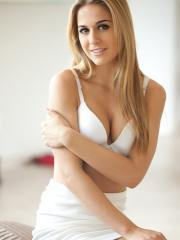 Blonde girl Cassidy Cole strips down to her white skirt