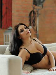 Busty hottie Charley S shows off her big boobs on the couch