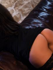 Charley S teasing in her black dress, pink lingerie and black stockings
