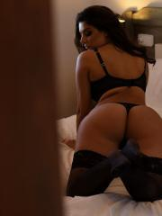 Charley teasing in black lingerie in the bedroom