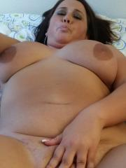 Chubby horny GF takes selfies as she gets naked on the bed