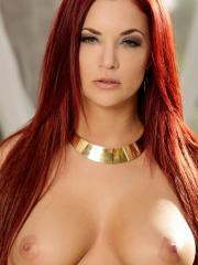 Redhead babe Jayden Cole lifts her lingerie to spread her pink pussy lips