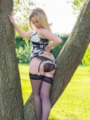 Blonde hottie Willow Hudson strips out of her dress and stockings outside