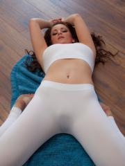 Busty redhead Emmy Sinclair does her Yoga topless