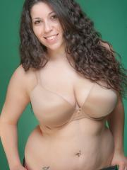 Curvy brunette Margaret Abello shows off her large round boobs