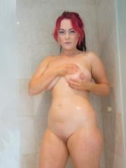 Curvy redhead Chikita Jones wants to take a shower with you