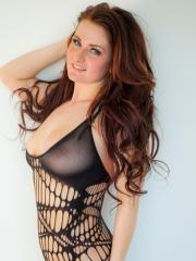 Busty babe Emmy Sinclair exposes her big natural boobs in a sexy bodysuit