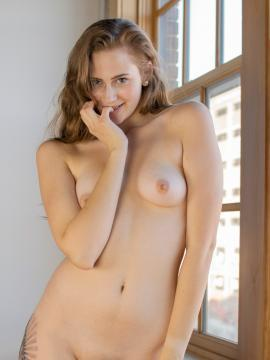 Holly Marie strips by window