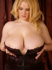 Pictures of big tit babe Ashley squeezing into a tight corset