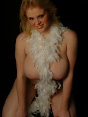 Ashley Ellison strips off and covers herself with feathers