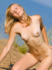 Pretty girl Mare displays her beautiful nude body outside