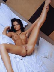 Stunning brunette Ardelia A gets fully nude and waits for you in bed