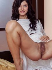 Arian bares her petite body and unshaved pussy on the floor