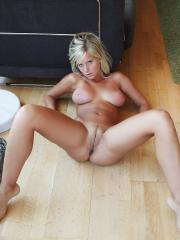 Pictures of Miela totally nude and spreading on the floor