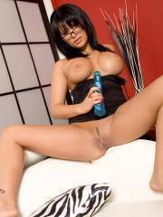 Pictures of Eva Angelina playing with her big blue vibrator