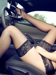 Beautiful girl Eve Thompson poses in her lingerie in the car