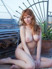 Pics of busty redhead Beatrix displaying her gorgeous nude body