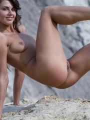Pictures of Alannis having some naked fun on the beach