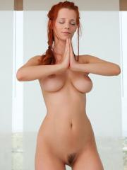 Hot redhead Ariel gets naked and does her yoga