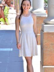 Brunette teen Lily shows you what's under her dress at the art gallery