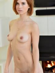 Redhead girl Pepper masturbates with a blue vibrator