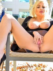Busty girl Katy exposes her big boobs and wet pussy outside