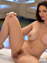"""Busty beauty Mindi gives you her nude body in """"A Seductive Look"""""""
