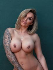 Gemma Massey strips for you on the tennis court