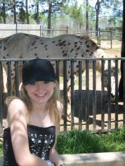 Cute teen Shelby visits the zoo for some candid photos